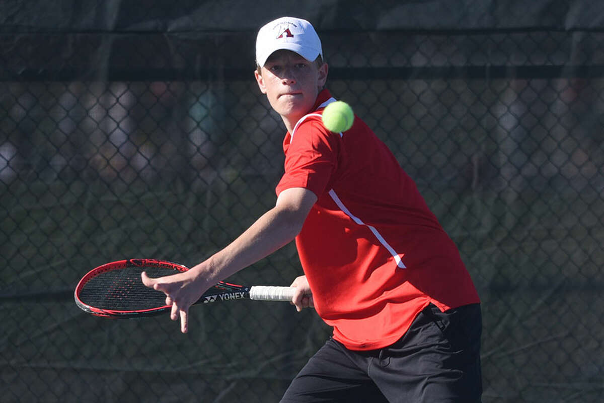 New Canaan's Matt Brand lines up a shot during a tennis match at NCHS last spring. Brand returns as a senior co-captain this season alongside Luke Crowley. - Dave Stewart photo