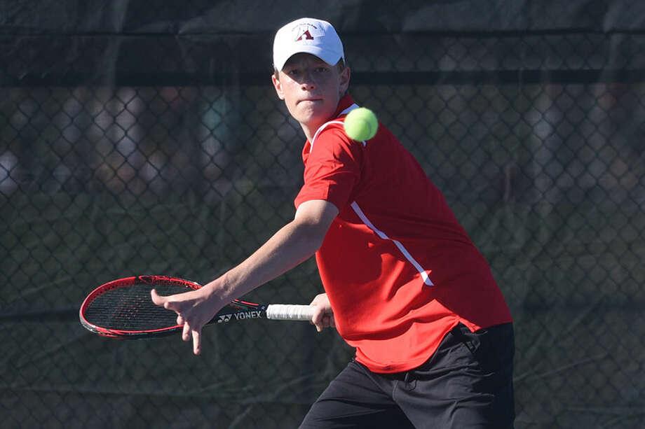 New Canaan's Matt Brand lines up a shot during a tennis match at NCHS last spring. Brand returns as a senior co-captain this season alongside Luke Crowley. — Dave Stewart photo