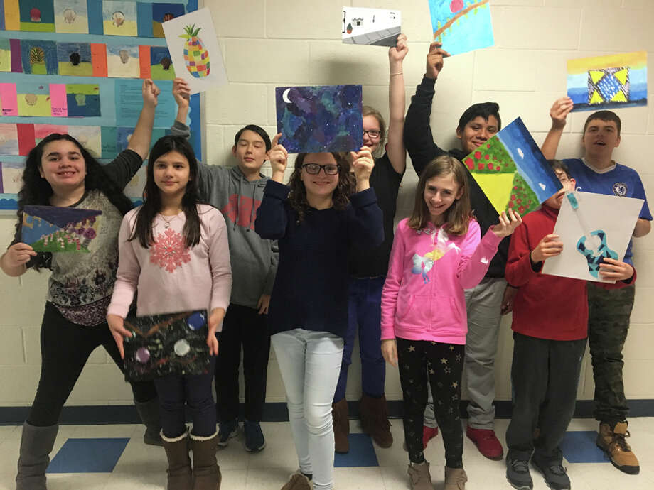 Colgate-Palmolive has awarded a $5,000 grant to Silvermine Art Partners for a studio-art program and cultural exchange. Students at Nathan Hale Middle School in Norwalk show their art projects done under the direction of a Teaching Artist from Silvermine's Outreach Education Program, Art Partners. — Silvermine Arts Center / Contributed photo