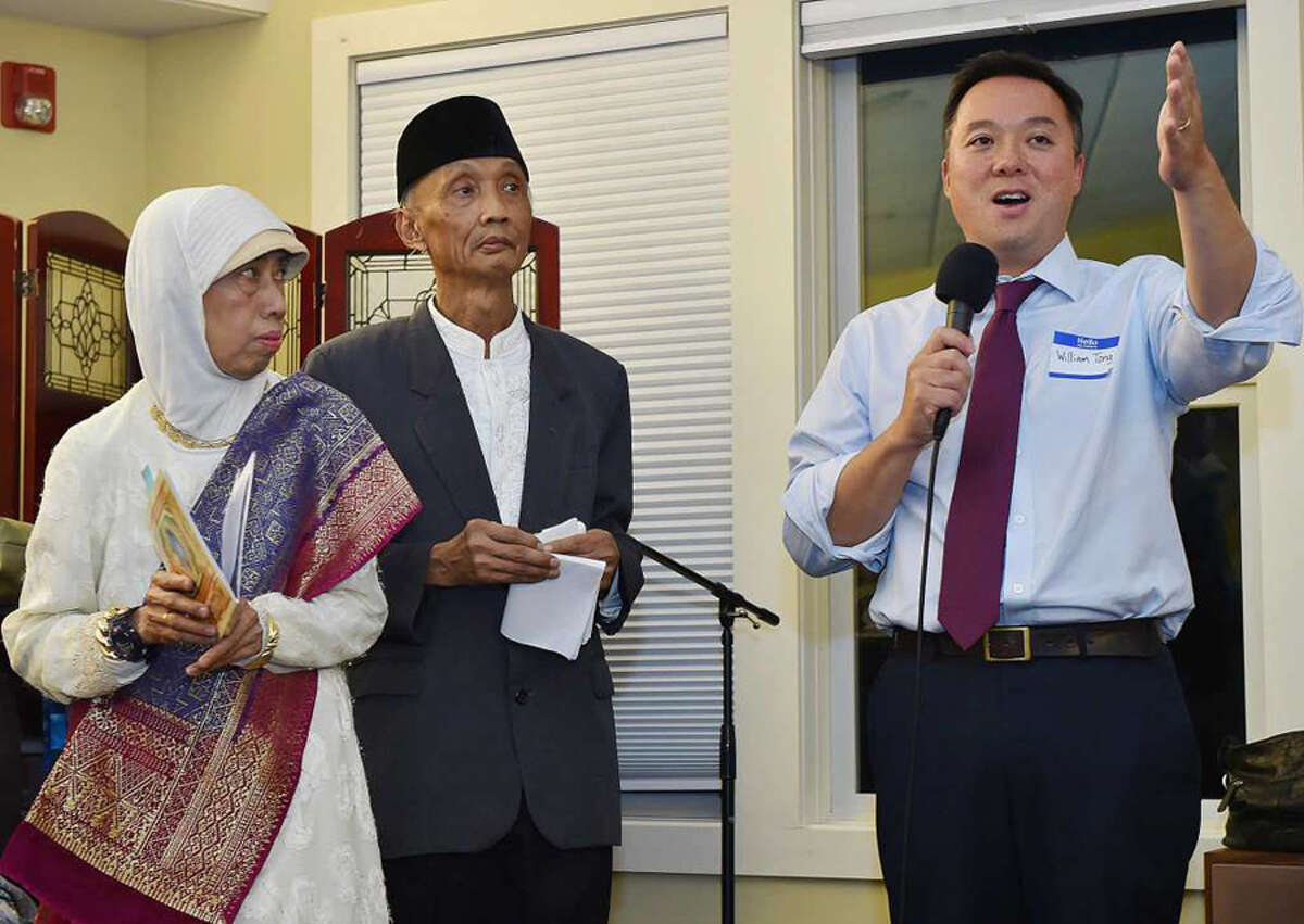 William Tong, the Democratic candidate for attorney general speaks about immigration at a service held for Indonesian immigrants Sujitno Sajuti and his wife Dahlia who have been in sanctuary for one year at the Unitarian Universalist Church in Meriden, Tuesday, October 9, 2018. - Catherine Avalone / Hearst Connecticut Media