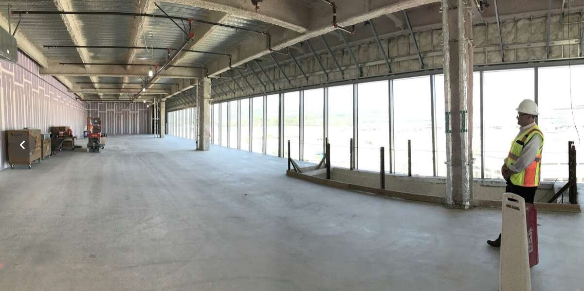 Half of the enormous space that will house American Airlines Admirals Club opening October 2020