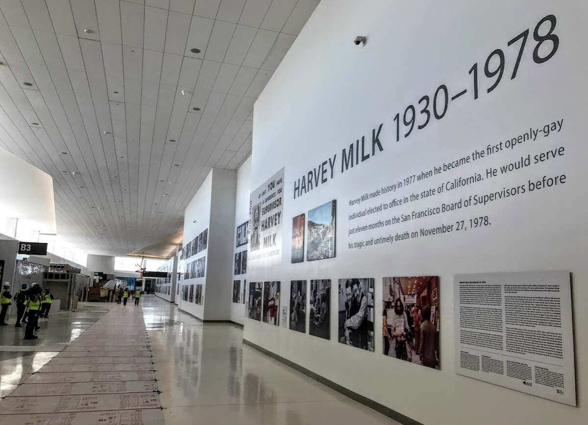 Travelers are greeted by a 400-foot temporary wall at SFO with a memorial to the life and times of Harvey B Milk, a local civil rights pioneer assassinated in 1978.