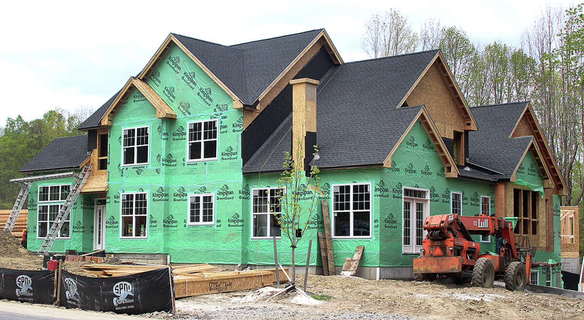 A Toll Brothers home under construction in Danbury, Conn. in May 2017. Toll Brothers is one of 100 publicly traded companies whose stocks are indexed in the HOMZ exchange-traded fund that debuted this month by Norwalk-based Hoya Capital Real Estate. - Chris Boask / Hearst Connecticut Media