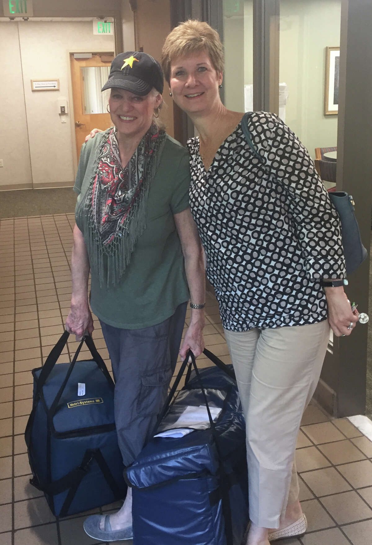 Volunteers deliver Meals on Wheels in New Canaan. The service is available to all who need help getting food from the store and cooking, regardless of age, and volunteers are needed to help with deliveries. - Meals on Wheels of New Canaan / Contributed photo