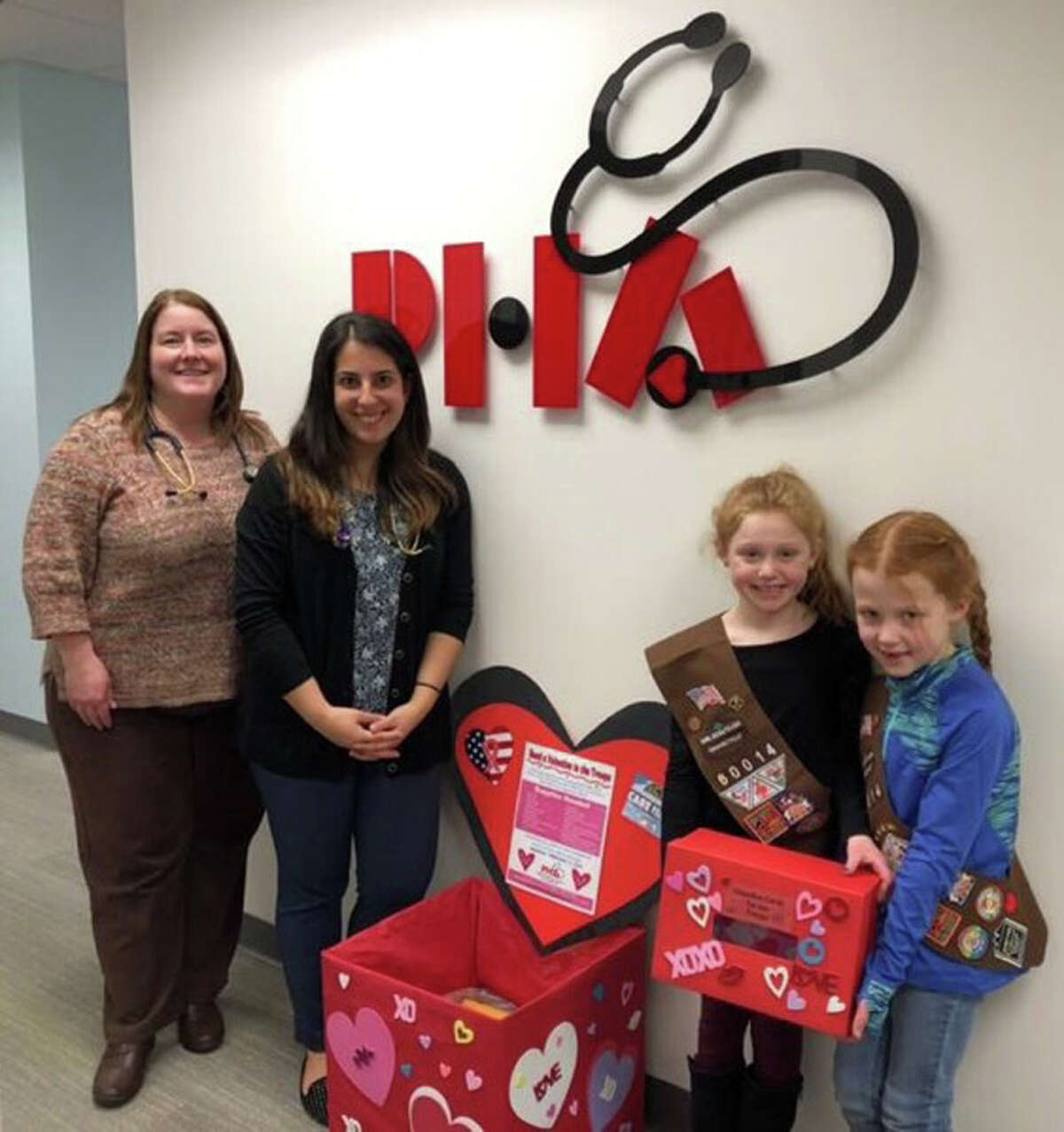 Pediatric Healthcare Associates hosted their annual Soldier Supply Drive to send care packages to the deployed troops overseas. Handmade Valentine's Day cards thanking the soldiers for their commitment and bravery were encouraged. Dr. Corrie Steeves and Dr. Maggie Kissel were presented with cards from Gianna Garofalo and Aria Chiaramonte of Brownie Troop 60014. - Contributed photo