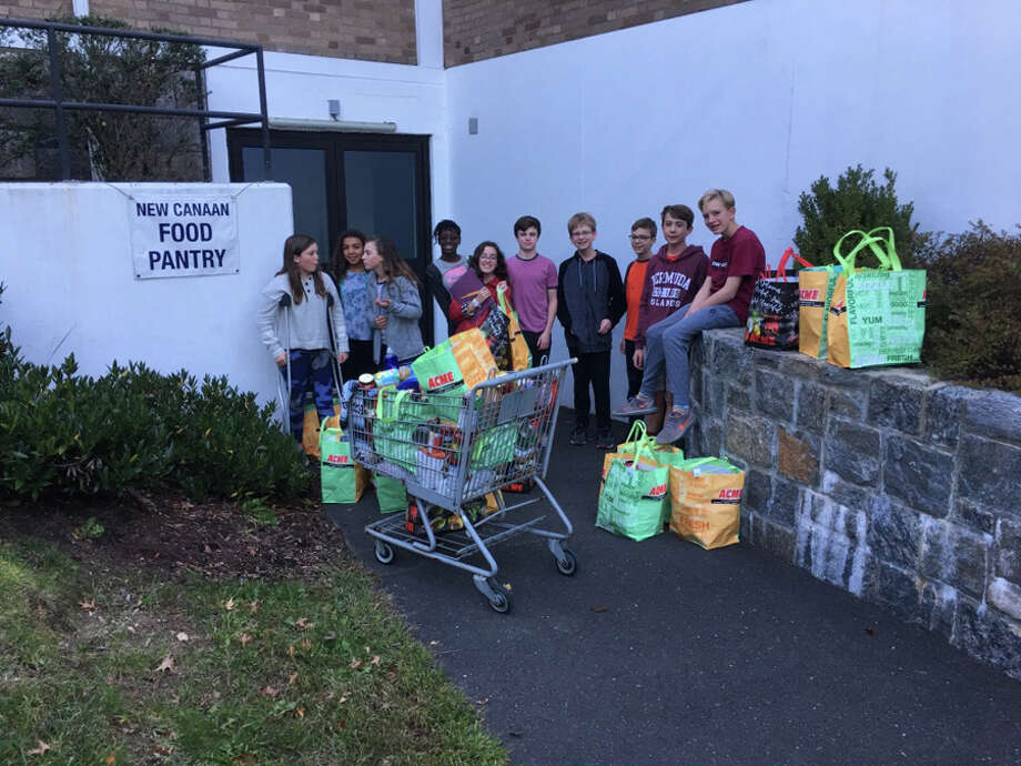 Students in the First Presbyterian Church of New Canaan Confirmation class deliver food to New Canaan Food Pantry where supplies are needed.