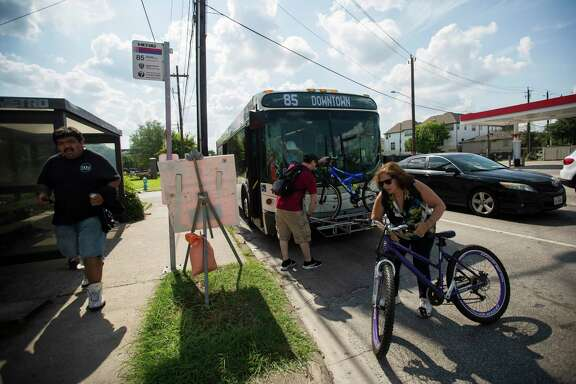 Commuters leave a Metro Route 85 bus at Washington and Studemont on June 11.