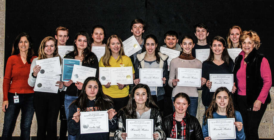 New Canaan High School students earned 23 awards in the Connecticut Scholastic Art Awards Competition, and one student earned a national award. In front are Caroline Tuffy, Demetria Dresser, Marina Forni, and Ann Pakhayev. in the second row are teacher Kimanne Core, Ava Nichols, Gwenan Walker, Charlie Gardner, Hannah Suthons, Amelia Maggard, Morgan Hibbert and teacher Jeanne McDonagh. In back are Andrew Jameson, Emma Uzgiris, Reid Dahill, Timothy Hardy, Peter Harvey, Jane Charlton, who won a National Silver Medal. Students Devin Findlay, Jackson Oehmler and Thomas Williams were also in the competition. — New Canaan High School / Contributed photo / Connecticut Post