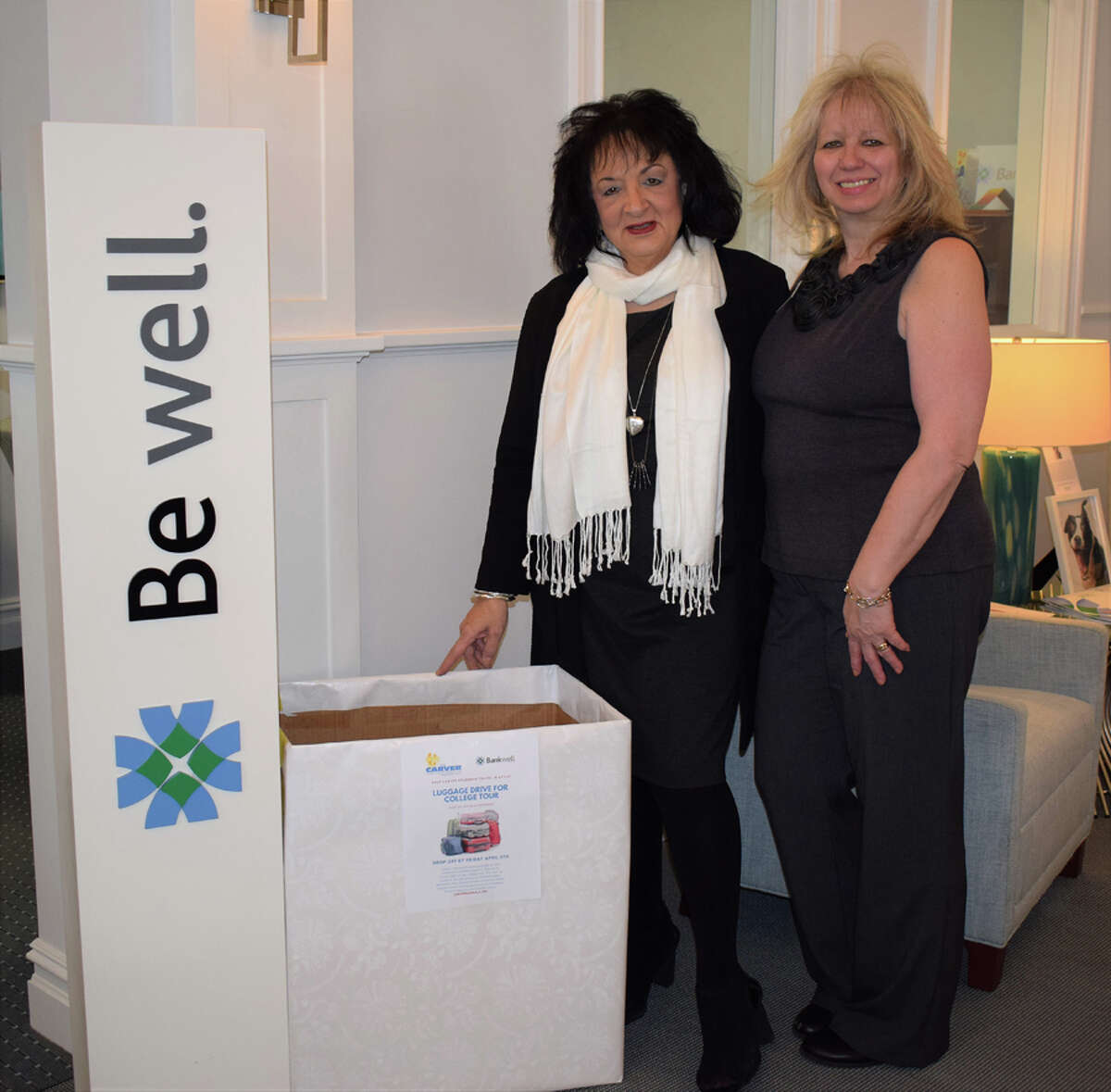 Bankwell in New Canaan Branch Manager, Flo Carbone and Universal Banker at Bankwell in New Canaan, Martha Melitsanopoulos with luggage being collected for the Carver Foundation's College Tour.- Contributed photo