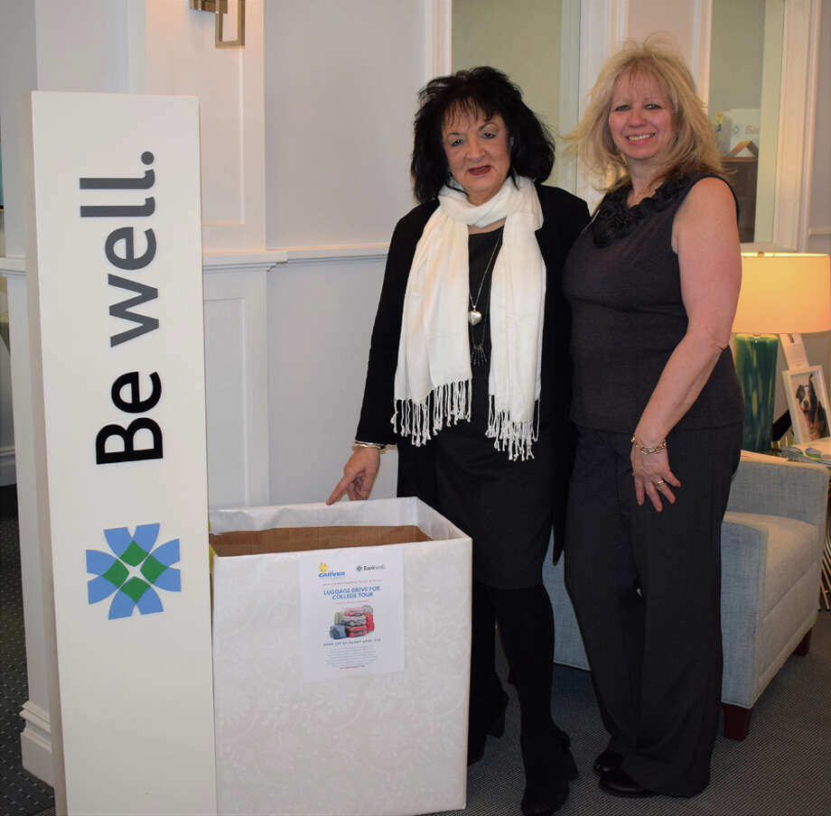 Bankwell in New Canaan Branch Manager, Flo Carbone and Universal Banker at Bankwell in New Canaan, Martha Melitsanopoulos with luggage being collected for the Carver Foundation's College Tour.— Contributed photo / Connecticut Post