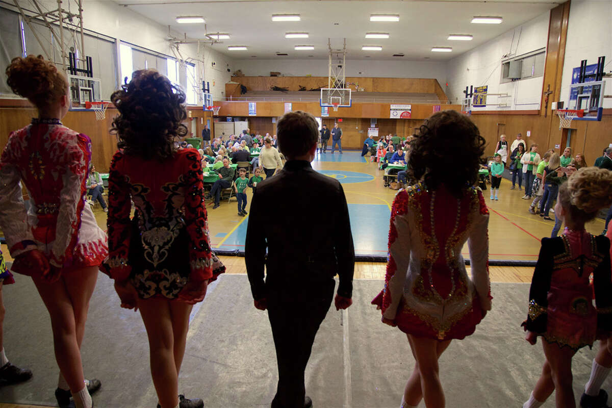 Members of the Harney Pender Keady dance troupe of Stamford prepare to begin in the gymnasium at St. Aloysius. - Jarret Liotta for Hearst Connecticut Media