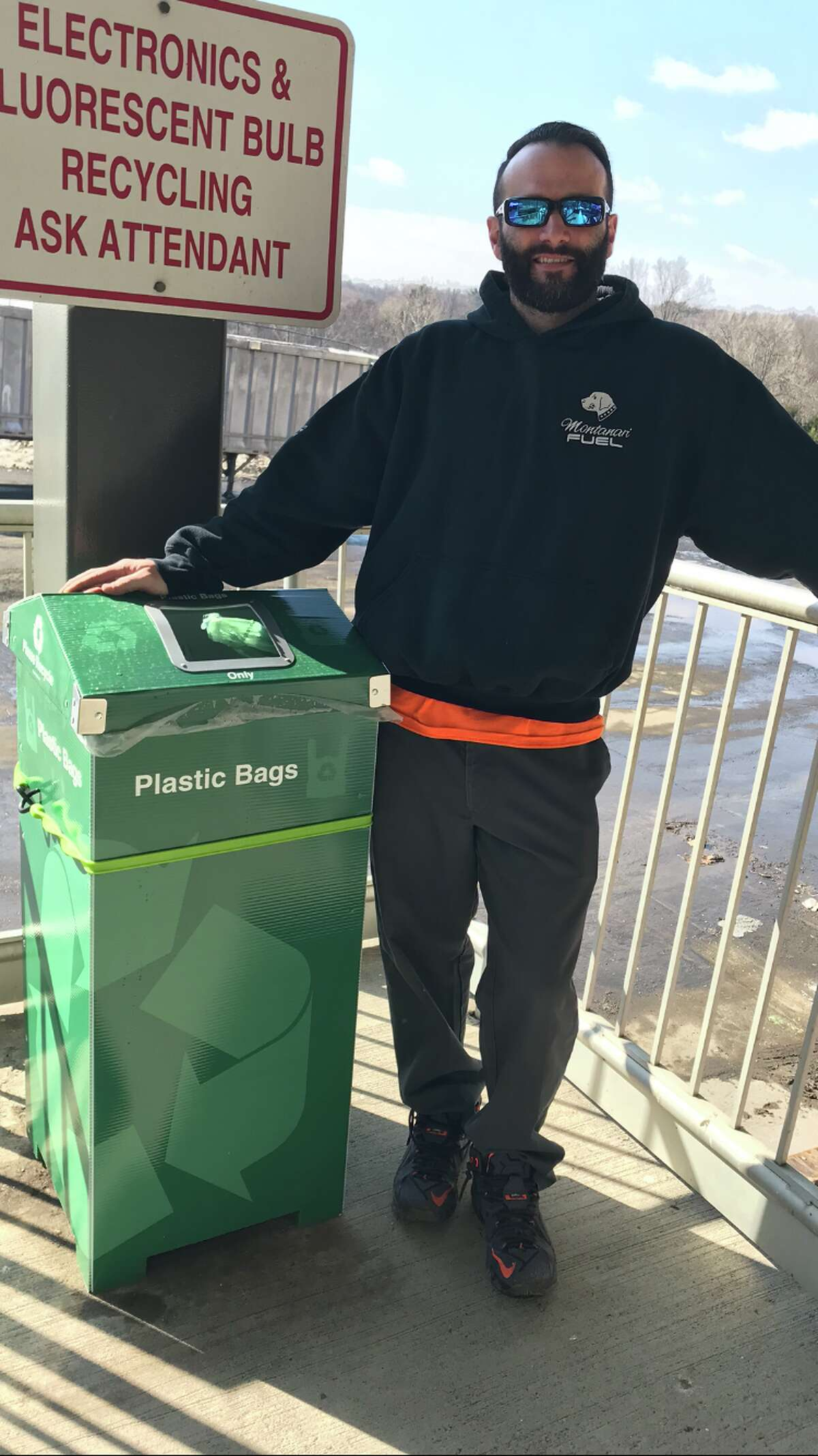 Eric Pote of The New Canaan Transfer Station stands next to a receptacle at the facility.- Planet New Canaan / Contributed Photo