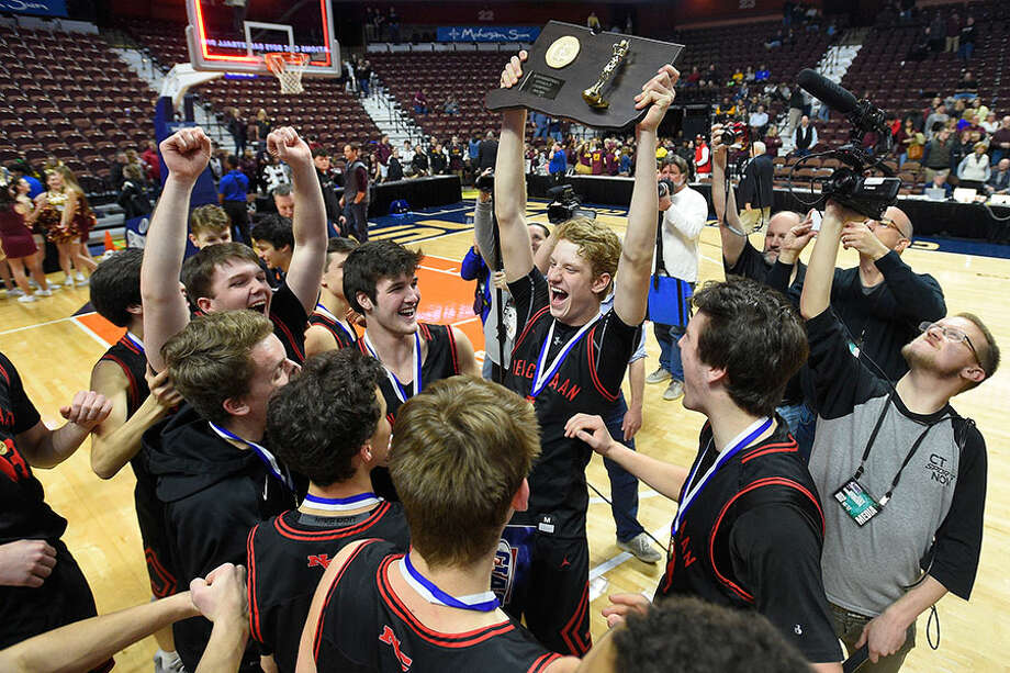 New Canaan celebrates with the championship plaque after defeating Granby 55-39 in the CIAC Div. IV final at Mohegan Sun Arenaon Saturday, March 16. — Matthew Brown/Hearst Connecticut Media / Stamford Advocate
