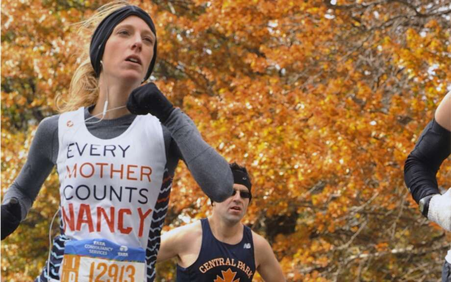 New Canaan High School graduate from the Class of 2005, Nancy Clayton, runs in the New York City Marathon in 2014. New Canaan-based First Candle, is an official charity partner for this year's race, Nov. 3, 2019. — Contributed photo