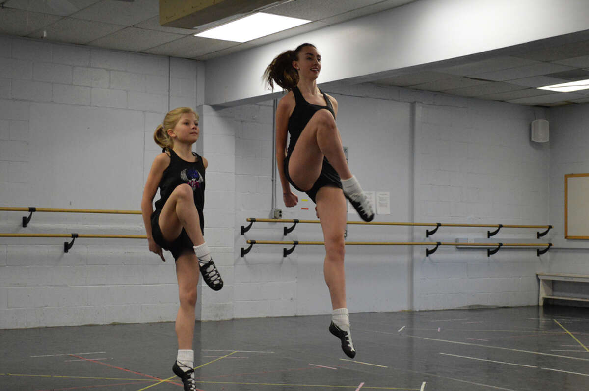 Leighton Busby and Shannon Jordan practice a dance atthe Harney Pender Keady Academy dance studio in Stamford.- Contributed photo
