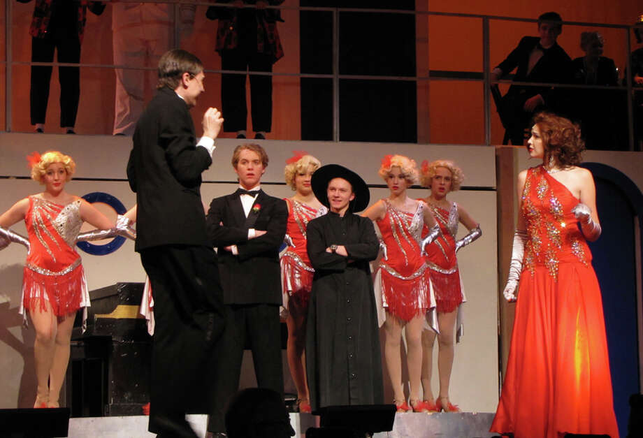 "Cast members are shown at a dress rehearsal for Anything Goes opening this weekend at New Canaan High School. Center is Wyatt Lysenko, ""Billy Crocker"" and to his right William Haddad ""Moonface Martin""; along with Sadie Seelert playing ""Reno Sweeney""; and Angels in the background. — New Canaan Theatre Department / Contributed photo"