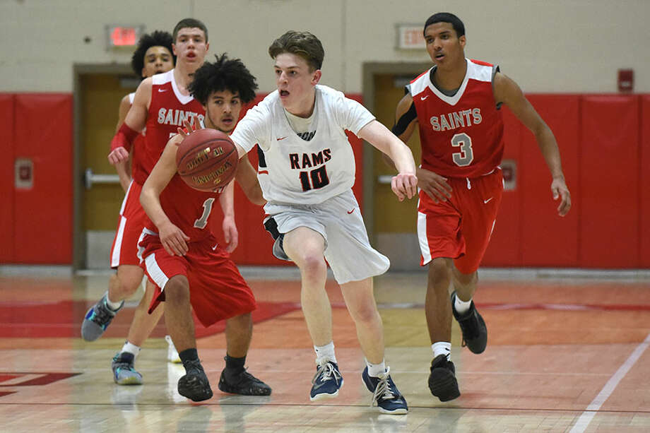 New Canaan's Ryan McAleer (10) breaks away from St. Bernard's Frank Pavheco (1) and Joseph Beltran (3) during the CIAC Div. IV quarterfinals Friday at NCHS. — Dave Stewart/Hearst Connecticut Media