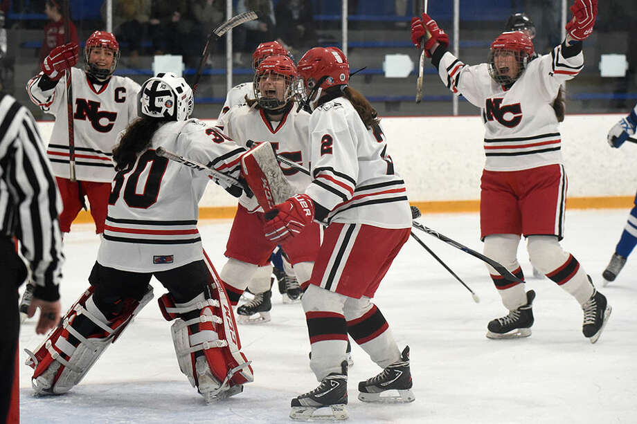 The New Canaan Rams begin their celebration after winning the CHSGHA state championship with a 3-1 victory over Darien in the final at Bennett Rink in West Haven on Saturday, March 9. — Dave Stewart/Hearst Connecticut Media / Hearst Connecticut Media