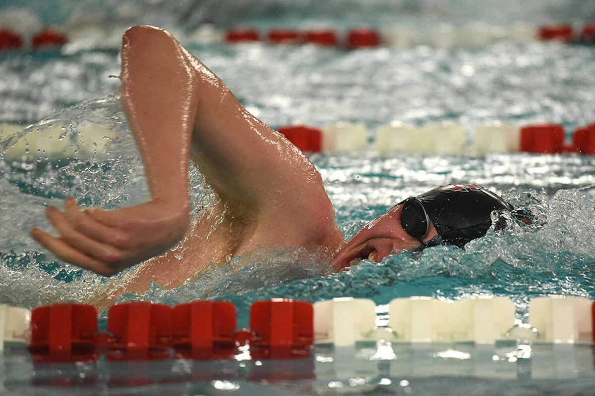 New Canaan senior co-captain Jake Ritz competes in the 500 freestyle during the FCIAC finals on Feb. 28