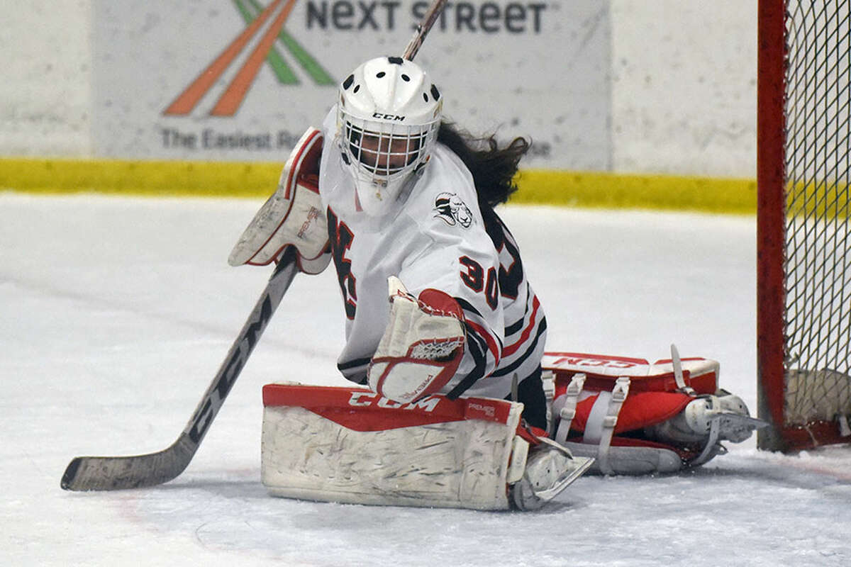 New Canaan goalie Blythe Novick makes a glove save during the CHSGHA State semifinals at The Rinks at Shelton on Wednesday, March 6. - Dave Stewart/Hearst Connecticut Media