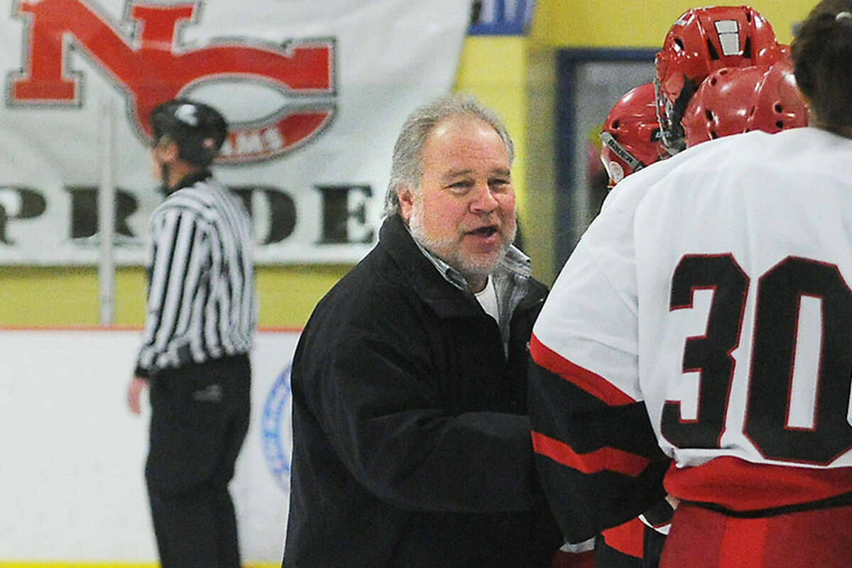 New Canaan's Rich Bulan congratulates his players after a win in the 2011 FCIAC championship game. Bulan, who has led the Rams to six FCIAC and six state titles, earned his 350th win with New Canaan on Saturday night. - Kathleen O'Rourke/Hearst Connecticut Media photo
