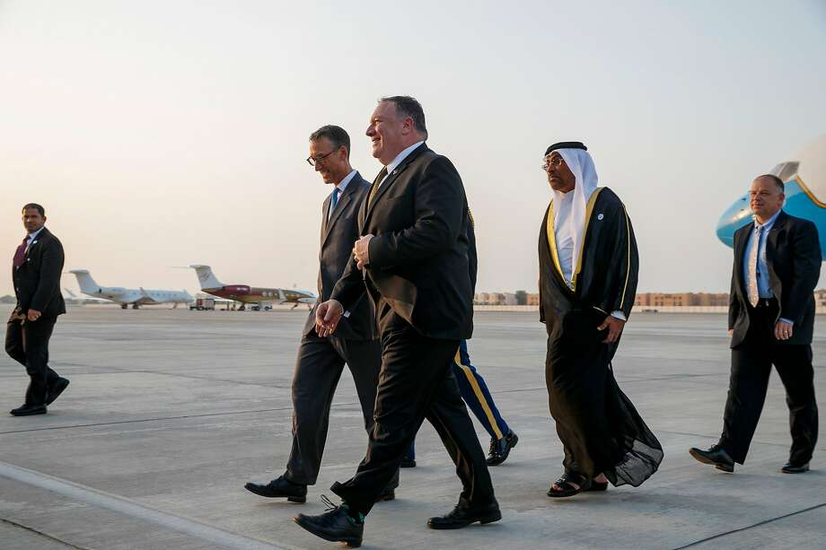 "US Secretary of State Mike Pompeo (C) walks with US Embassy Charge d'Affaire Steve Bondy (L) and United Arab Emirates Minister of State Ahmed al-Sayegh (R) as Pompeo arrives in Abu Dhabi on June 24, 2019, for talks on Iran. US Embassy Charge d'Affaire - The United States, Britain, Saudi Arabia and the United Arab Emirates have jointly called for ""diplomatic solutions"" to ease soaring tensions with Iran. (Photo by Jacquelyn Martin / POOL / AFP)JACQUELYN MARTIN/AFP/Getty Images Photo: Jacquelyn Martin, AFP/Getty Images"