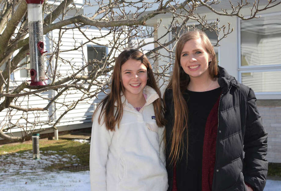 New Canaan Country School student Jane Walsh, with her science teacher Margaret Mackey, conducted a month-long experiment to find out if birds prefer music.