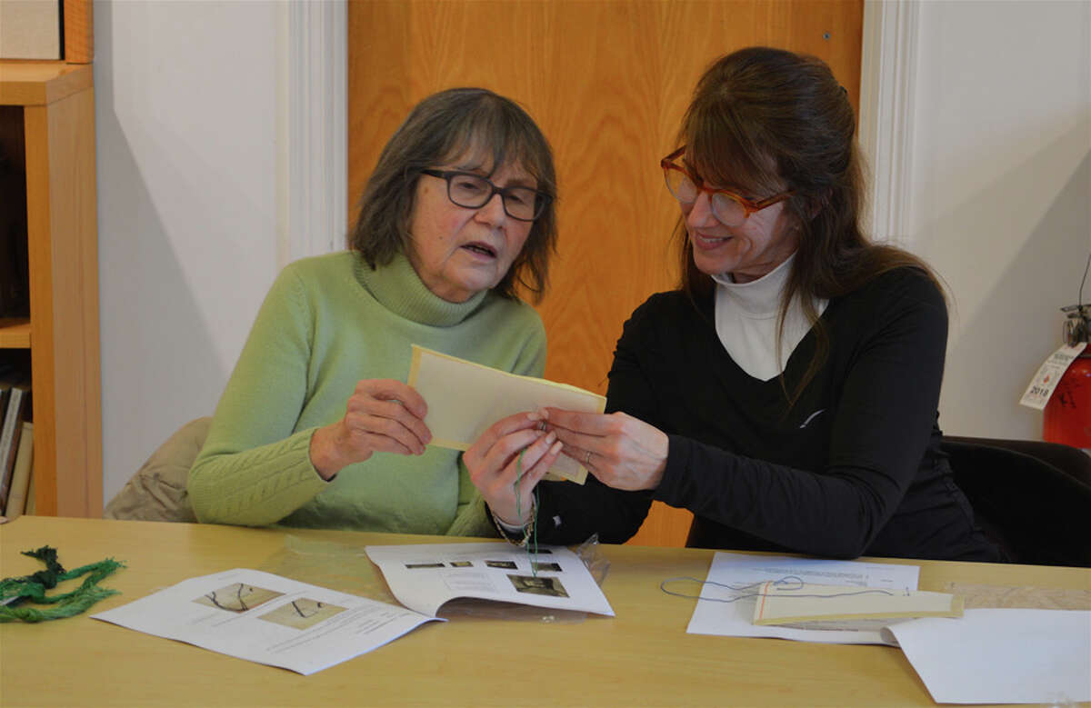 Mary Ward, left, and Christie Hartnett, both of New Canaan, review their work together at the introductory needlepoint class at New Canaan Library on Sunday, Feb. 24, 2019. Jarret Liotta Hearst Connecticut Media