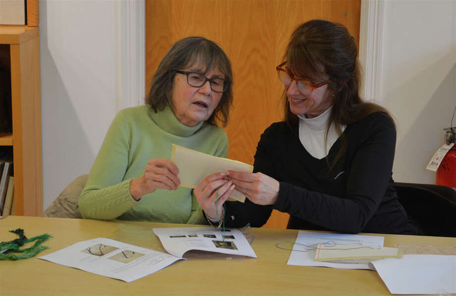 Mary Ward, left, and Christie Hartnett, both of New Canaan, review their work together at the introductory needlepoint class at New Canaan Library on Sunday, Feb. 24, 2019. Jarret Liotta Hearst Connecticut Media / Connecticut Post