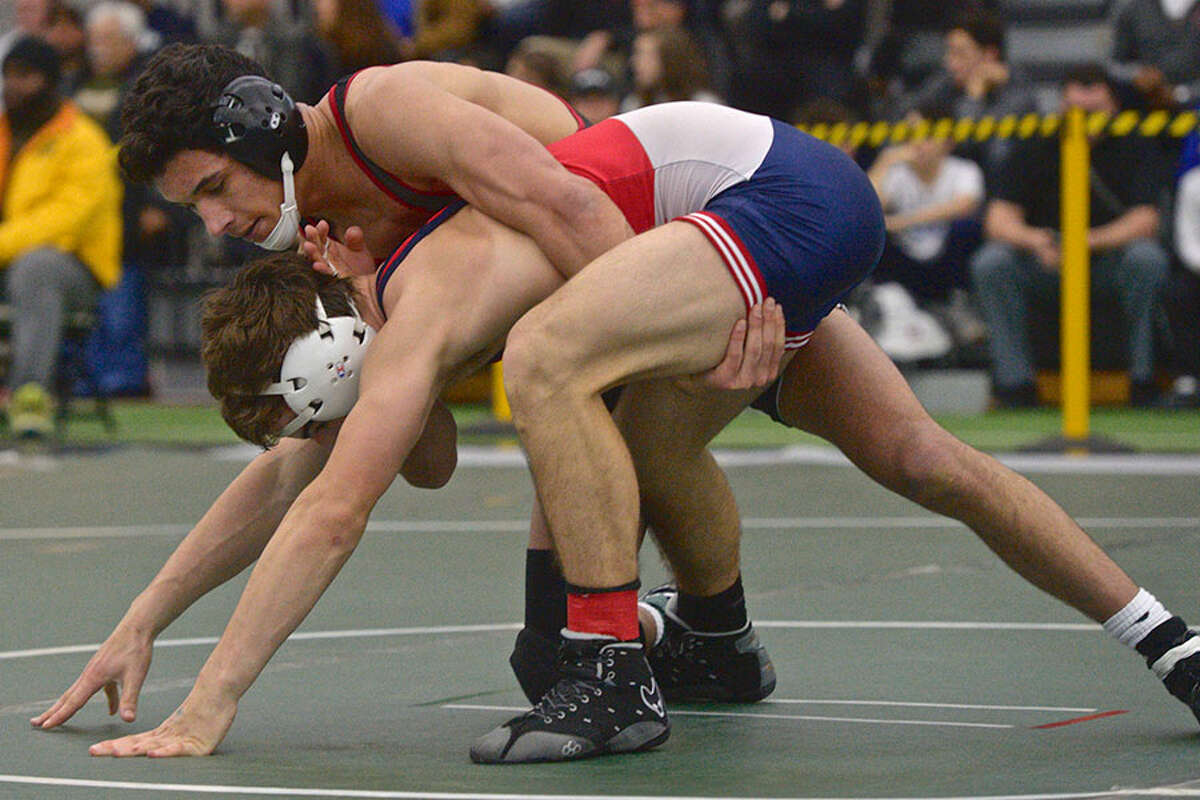 New Canaan's Tyler Sung and Berlin's Daniel Veleas wrestle in the finals for the 142-pound weight class in the Connecticut State Open championships, Saturday, February 23, 2019, at the Floyd Little Athletic Center, New Haven, Conn. - H John Voorhees III/Hearst Connecticut Media