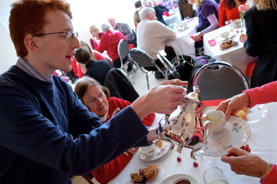 Mike Murphy, librarian archivist at the New Canaan Historical Society, deftly serves the tea at the annual Valentine's Day tea on Thursday, Feb. 14, 2019. Jarret Liotta / Hearst Connecticut Media / Connecticut Post