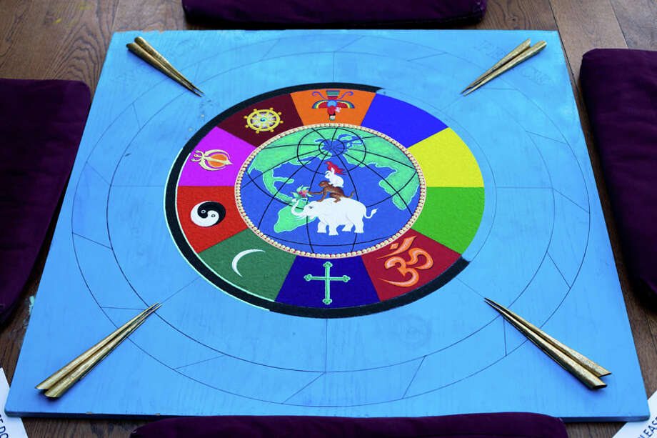 Labrang Tashi Kyil monks created a Sacred Sand Mandala on world peace — an initiative that took four days to complete and involved millions of grains of sand resulting in a multi-colored design, symbolizing harmony and healing — during a recent visit to Silver Hill Hospital. / Connecticut Post