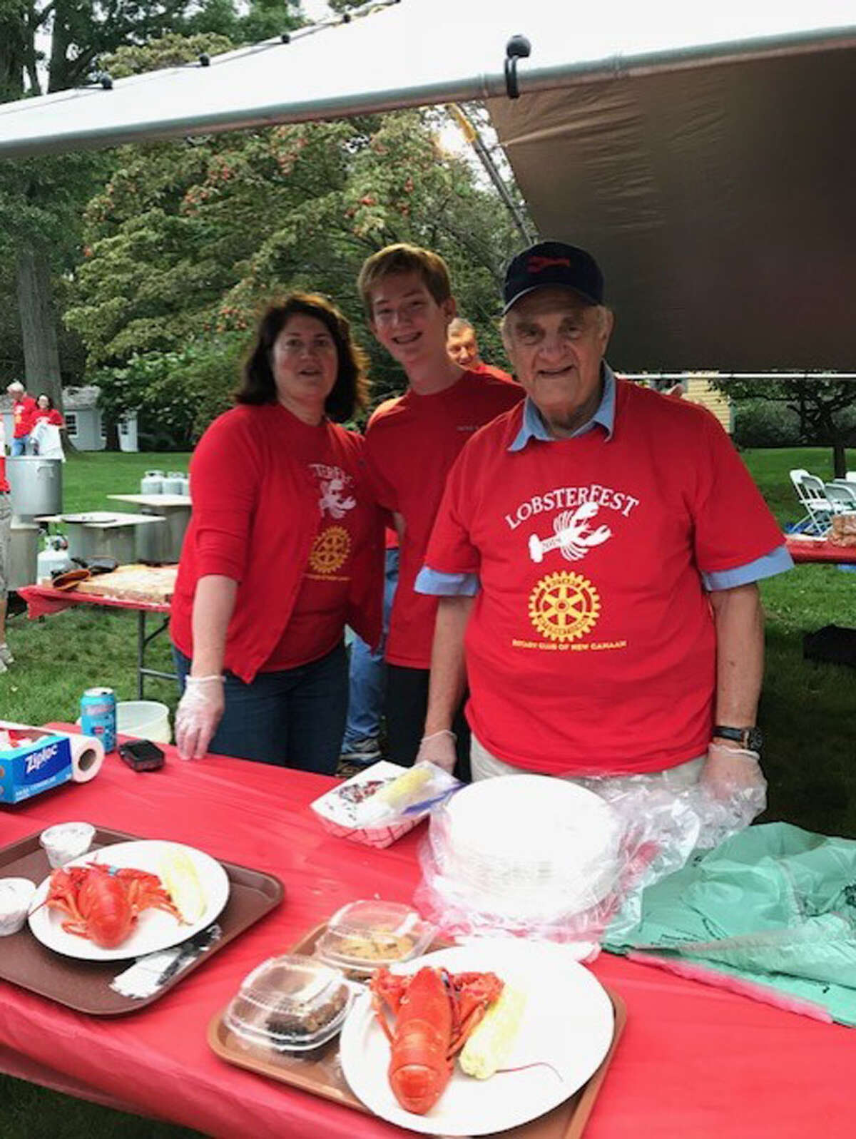 Above: Nic Butler, Anne Cheney, of Stewart's in New Canaan, and Keith Simpson, are members of New Canaan High School Service League of Boys-SLOBS. They helped out at Lobsterfest, an annual Rotary Club fundraiser, in September. SLOBS seeks new members. Below: Reid Dahil, Christopher Carratu, Jackson Oehmler, Griffin Dayton, Nicholas Lambrinos, Doyle Catlin, Colin Byrne of New Canaan High School Service League of Boys-SLOBS serve at the Rotary Club's Lobsterfest which is held every September. SLOBs seeks new members.
