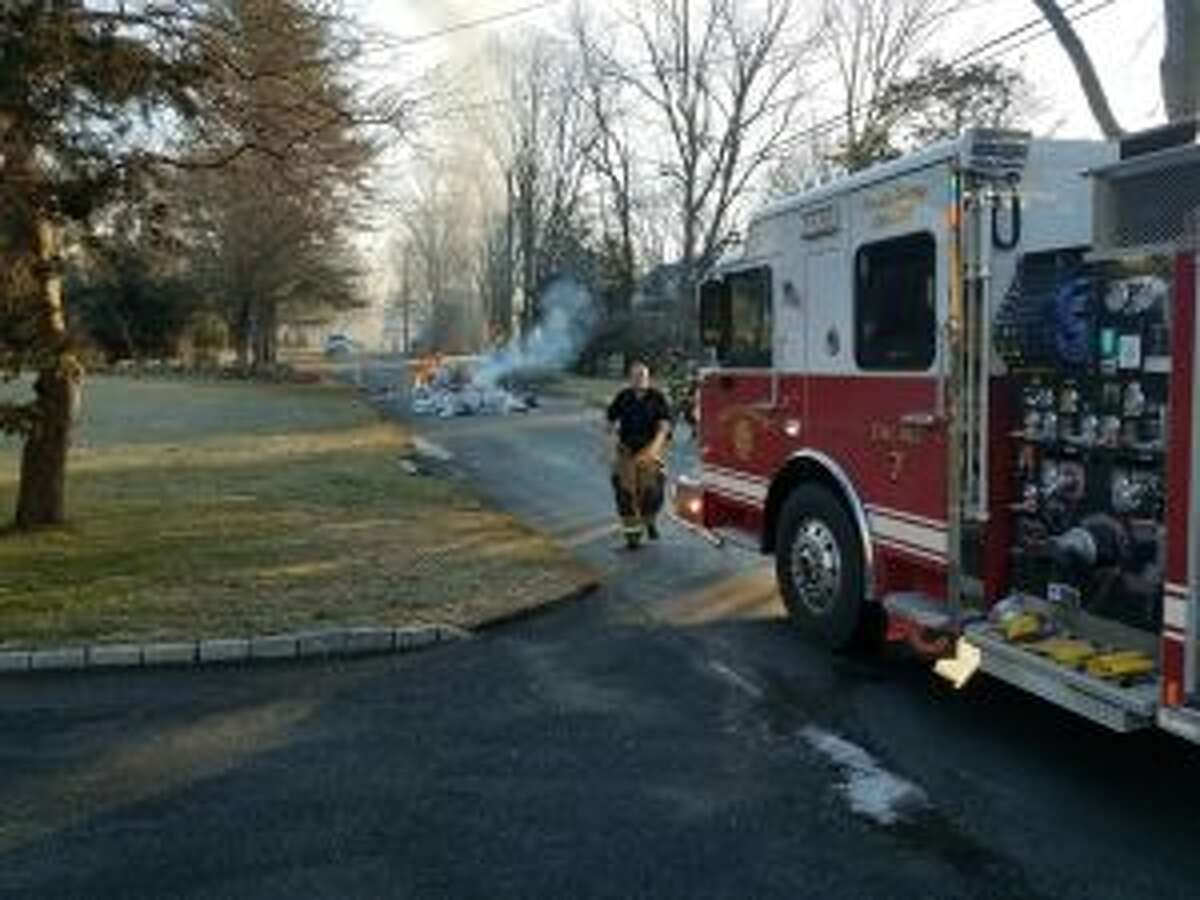 New Canaan Fire Department respond to a garbage truck fire Feb. 4 on Conrad Road.