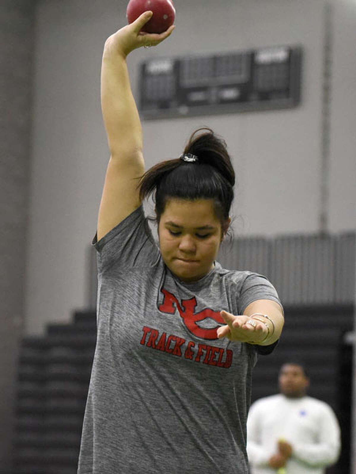 New Canaan junior Naomi Cimino gets ready for a throw during the girls shot put competition at the FCIAC indoor track and field championships in New Haven on Thursday, Jan. 31. - Dave Stewart/Hearst Connecticut Media photo