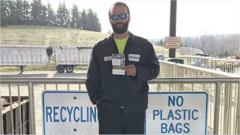 Eric Pote stands in front of signs at the New Canaan Transfer Station which has announced new guidelines for residents.
