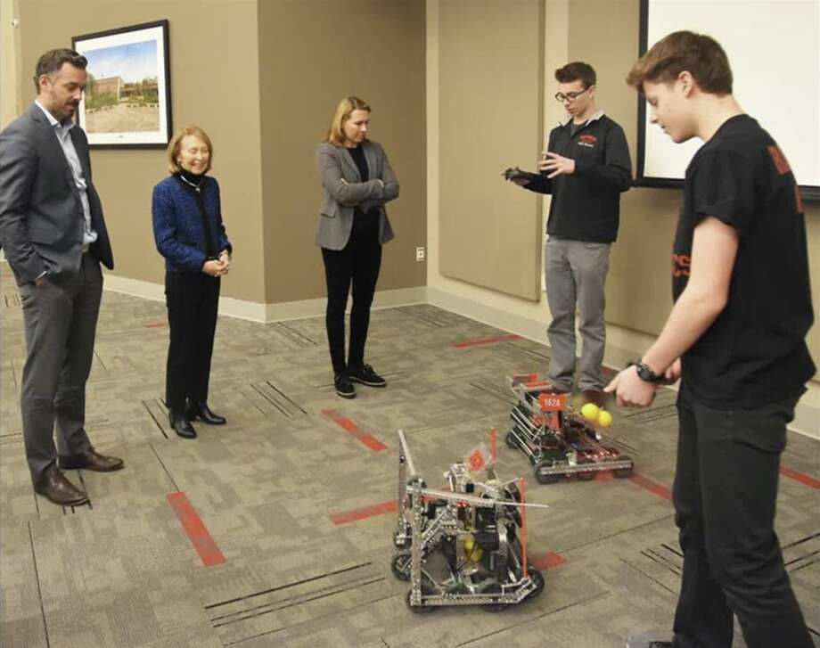 The New Canaan High School robotics team is headed to regionals. New Canaan High School Vex Robotics team members Ben Levin and Mark Levin (far right) make an informal presentation to Board of Education Chairman Brendan Hayes, member Hazel Hobbs, and Vice Chairman Dionna Carlson.