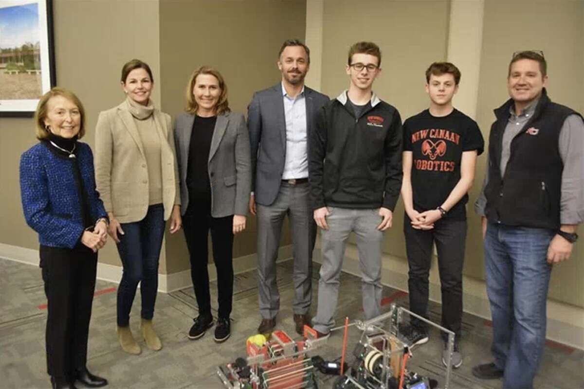 New Canaan Board of Education members Hazel Hobbs, Katrina Parkhill, Vice Chairman Dionna Carlson, and Chairman Brendan Hayes catch up with New Canaan High School Vex Robotics Team members Ben Levin and Mark Levin, and NCHS Technology teacher Jim Zambarano. The team has advanced to the Southern New England Vex Robotics Regional Competition taking place next month, and members of the team made an informal presentation to the Board of Education prior to a recent meeting.