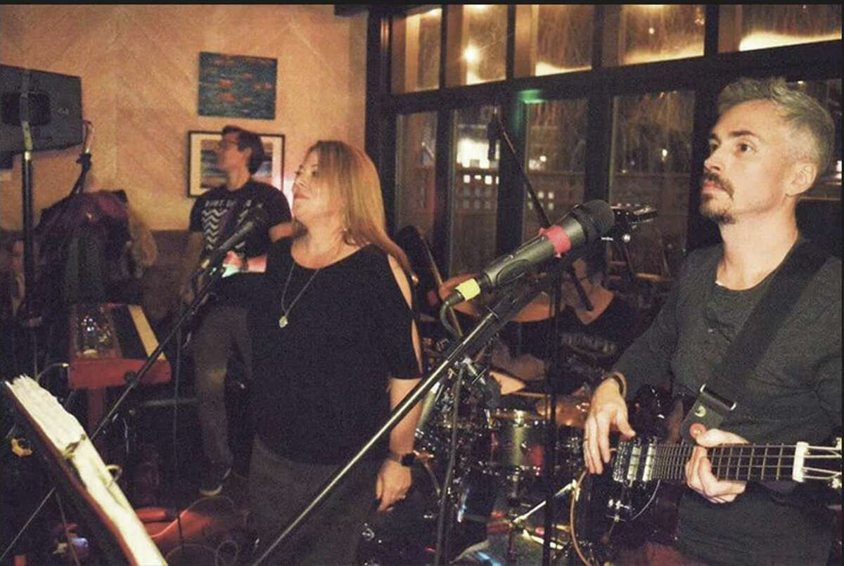 Sideways members Jen Kane guest singer, Sloan Alexander, Doug Stewart, and Sean Jackson, all of New Canaan, at the Battle of the Bands at Gates Restaurant, Saturday, Feb. 2, 2019, in New Canaan, Conn.