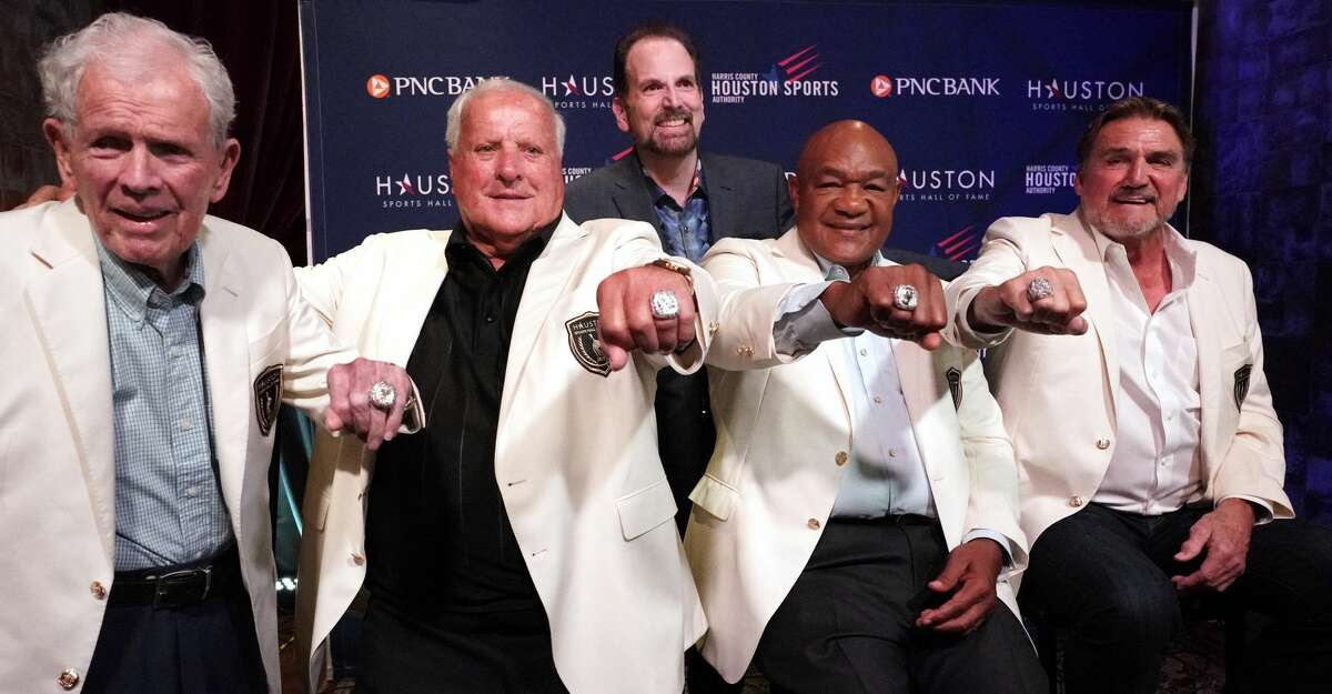 Masters champion Jackie Burke Jr., left, four-time Indianapolis 500 champion A.J. Foyt, two-time world heavyweight boxing champion George Foreman and former Oilers quarterback Dan Pastorini, right, display their rings as they pose with Fred Cuellar, of Diamond Cutters Int., back center, during the Houston Sports Hall of Fame ceremony June 25 at House of Blues.