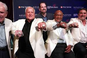 Masters champion Jackie Burke Jr., left, four-time Indianapolis 500 champion A.J. Foyt, two-time world heavyweight boxing champion George Foreman and former Oilers quarterback Dan Pastorini, right,  display their hall of fame rings as they pose with Fred Cuellar, of Diamond Cutters Int., back center, during the Houston Sports Hall of Fame ceremony held at House of Blues 1204 Caroline, Tuesday, June 25, 2019, in Houston.