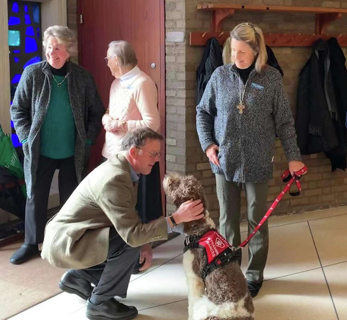 Nine-month-old Goldendoodle Frances is the Pastoral Pup in a new outreach ministry at St. Mark's Episcopal Church. She is shown with Lila Coleman, Jane Corcoran, Wendy Hilboldt and Jim Hilboldt.