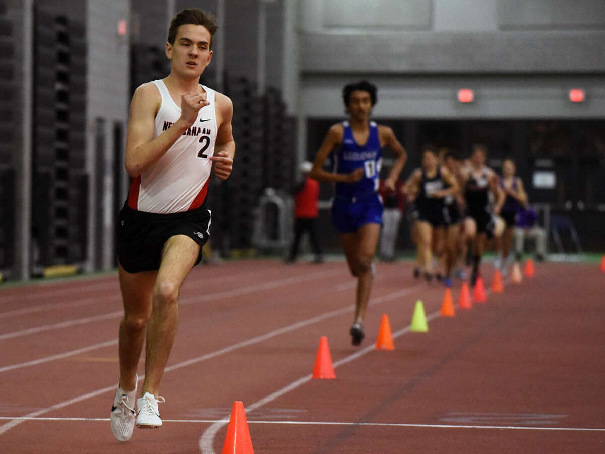 New Canaan senior Andrew Malling leads a pack of runners during the 3,200-meter run at the FCIAC indoor track and field championships at the Floyd Little Athletic Center in New Haven on Thursday, Jan. 31. - Dave Stewart/Hearst Connecticut Media photo