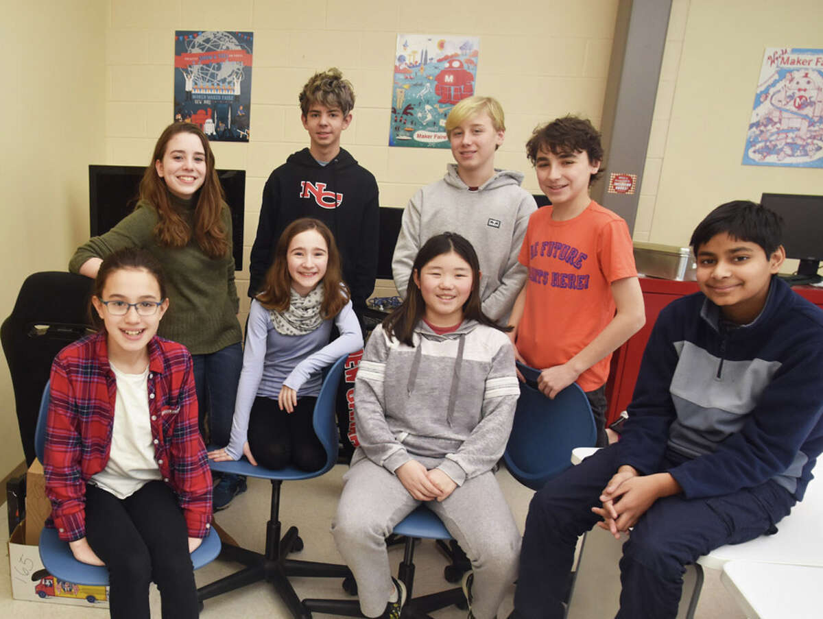 A group of Saxe Middle School 7th and 8th grade STEM students are Connecticut champions in the Samsung Solve for Tomorrow Contest. The team of students consists of Kailin Downey, Alexandra McManus, Lily Auerbach, and Anav Sahay (seated, left-right); and Alexandra Gelvin, Alex Dathan, Gustav Neubohn and Ben Skrelunas (standing, left-right). Not shown, Sophia Lee. They now enter into the contest's national competition, after their proposal was recently chosen one of the top entries in the United States.