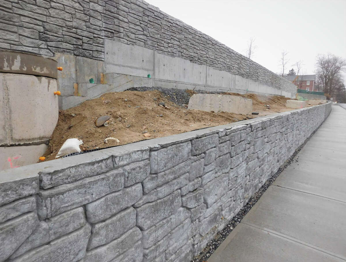 The New Canaan Planning and Zoning Commission is thinking about whether it should further act on the faux stone walls at the site of the Merritt Village project. Pictured are some of the walls.