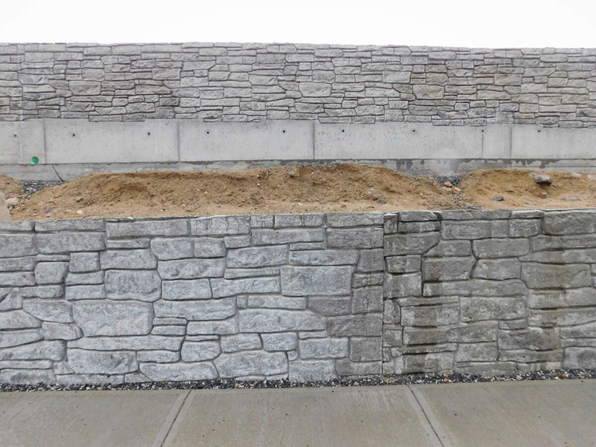 Some of the faux stone walls at the site of the Merritt Village project.