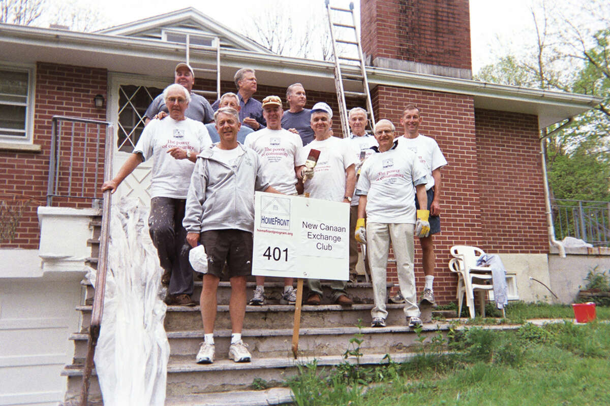 New Canaan Exchange Club volunteers are shown at a home revitalization project. HomeFront has presented the club with its Community Cornerstone Award for 25 years of service.