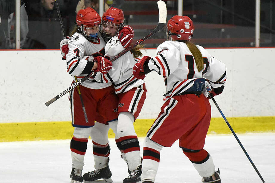 New Canaan's Jess Eccleston (7), Angelica Megdanis (13) and Sadie Frame (17) celebrate Eccleston's third-period goal in a 3-2 win over Greenwich at the Darien Ice House on Friday, Jan. 18. — Dave Stewart/Hearst Connecticut Media photo