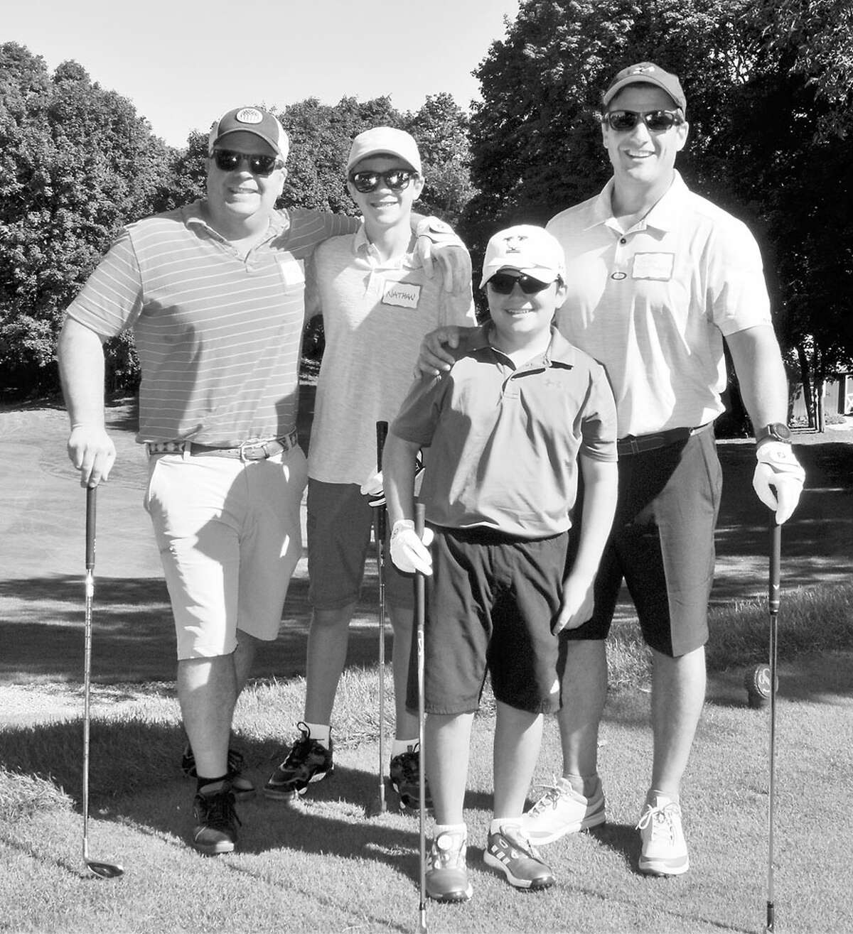 STAR's 9-hole family golf tourney raised $10,000. From left, Mike and Nathan Sieckhaus and John and Jason Konidaris shown at the recent tournament. - Contributed photo