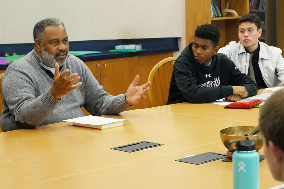 St. Luke's School students Desmond Pratt and Julian Velez listen to Anthony Ray Hinton, author of The Sun Does Shine: How I Found Life and Freedom on Death Row, during a visit to their school in December at which he spoke of spending decades in prison for a crime he did not commit. — Photo by Valerie Parker